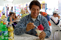 Zapotec man eating cactus flavored nieves oaxaquenos, oaxacan icecream