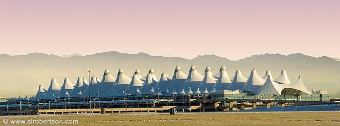 Denver International Airport Terminal (DIA) w/ Rocky Mountain range composited behind