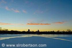 Denver Skyline across frozen Duck Lake at Sunset, City Park